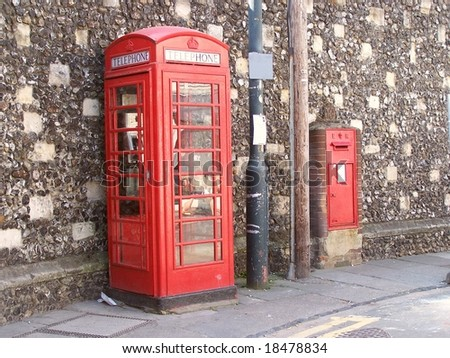 British red phone booth K6 & postbox against a Roman wall in Canterbury, Kent, UK