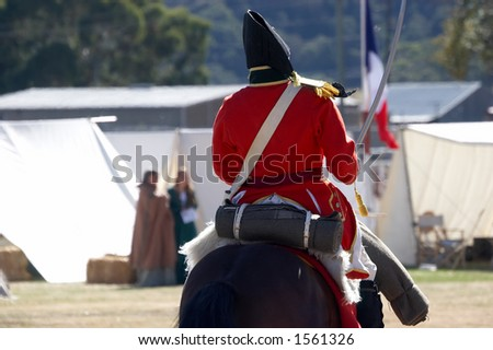 British redcoat riding into a French camp