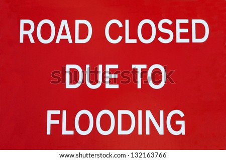 British Road Closed Due To Flooding road sign.