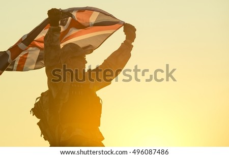British Soldier with UK Flag in His Hands. Military Concept.