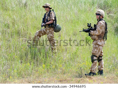 British soldiers in desert uniform in action