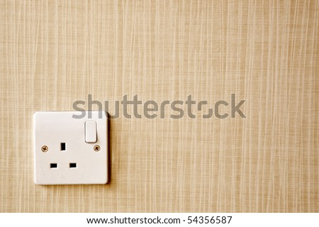British Standard BS 1363 AC power socket at the corner of a wall