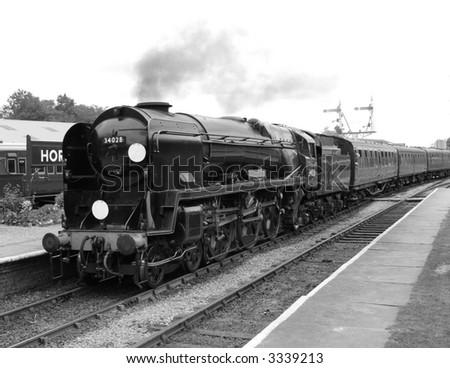 British steam train departs station