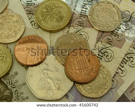 British sterling pound (GBP) notes and coins - stock photo