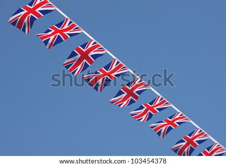 British Union Jack bunting flags against blue sky