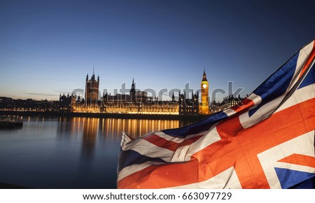 British union jack flag and Big Ben Clock Tower and Parliament house at city of Westminster in the background - UK votes to leave the EU, Brexit concept #663097729
