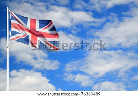 British Union Jack flag on cloudy sky with space for text - stock photo