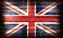British Union Jack flag painted on old plank dark wall