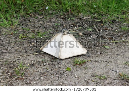 British world war two folding canvas on metal frame unexploded mine marker at a historic reenactment event on a background of soil and leaves. Stock photo ©