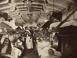 British WW1 wounded evacuated from France in a hospital train. 1914-18. Ambulances will transfer them to the base hospital.