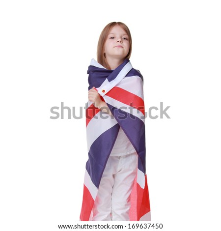 British young girl with a sweet smile, holding a flag of the United Kingdom isolated on white