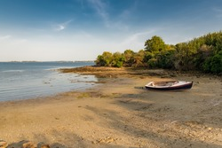 Brittany, Ile aux Moines island in the Morbihan gulf, beautiful beach at Penhap, with a wooden ship