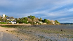 Brittany, Ile aux Moines island in the Morbihan gulf, the church and the Port-Miquel beach at low tide
