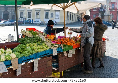 BRNO, CZECH REPUBLIC - MARCH 5: Locals buy vegetables at vegetables Market in Brno on March 5, 2011. Brno is the second largest city in the Czech Republic.