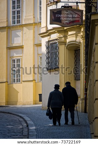 BRNO, CZECH REPUBLIC - MARCH 5: Old couple walking in Dominiknsk Street, in the town of Brno on March 5, 2011. Brno is the second largest city in the Czech Rep. and a very popular tourist destination.