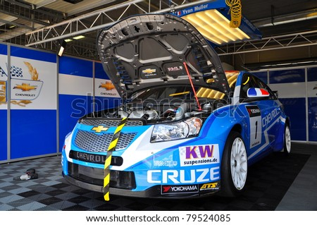 BRNO - JUNE 19: Car of Chevrolet team - Chevrolet Cruze in paddock in FIA WTCC, June 19, 2011 in Brno, Czech republic