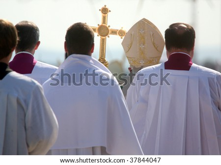 BRNO - SEPT 27: Holy father Pope Benedict XVI (2nd-R) is surrounded by priests as he celebrates a mass for about 120,000 pilgrims from central Europe on September 27, 2009 in Brno, Czech Republic.
