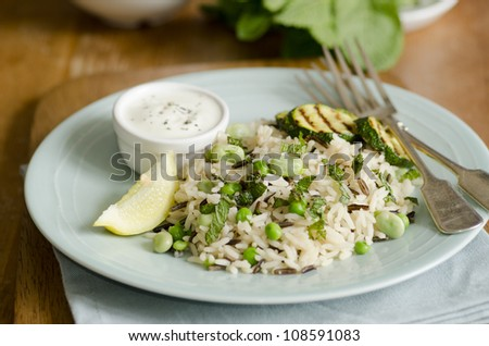 Broad bean and courgette pilaf with yogurt