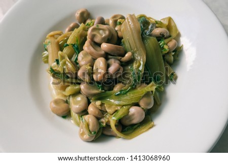broad beans and vegetables seasoned with olive oil.