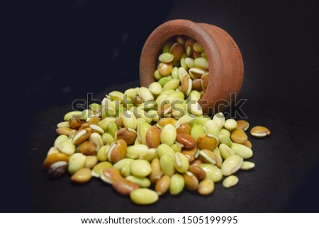 broad beans or fava beans isolated on a black background, Fresh broad beans in clay bowl on background