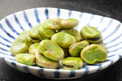 Broad beans salt boiled on a  plate
