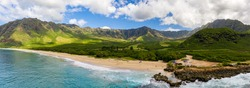 Broad panorama of Makua beach and valley from aerial view over the ocean on west coast of Oahu, Hawaii