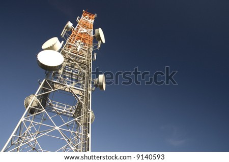 Broadcaster or transmitter tower with telecommunication satelites.
