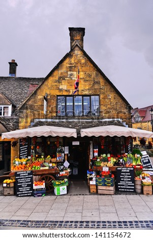BROADWAY, ENGLAND-APRIL 9: A local market in Broadway, England displays fresh produce for purchase on April 9, 2013.The type of fresh and local produce is available depending on the time of year.