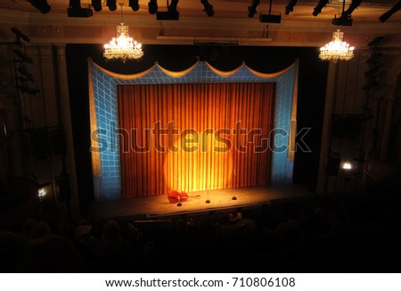 Broadway stage with spotlight and curtain - Shutterstock ID 710806108
