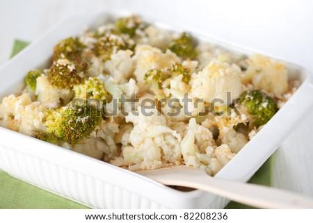 Broccoli and cauliflower gratin in white casserole