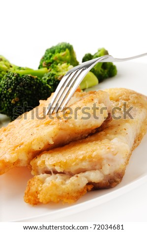 Broccoli and fish dish on white background
