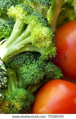 Broccoli and mature tomato. - stock photo
