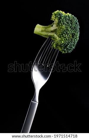 broccoli impaled on a fork on a black background. High quality photo Сток-фото ©