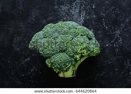 Broccoli on dark stone slate background. Top view