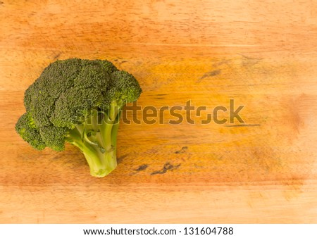 Broccoli on wooden chopping board background with copyspace