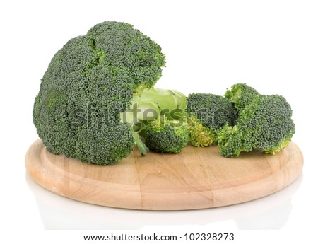 Broccoli on wooden chopping board isolated on white