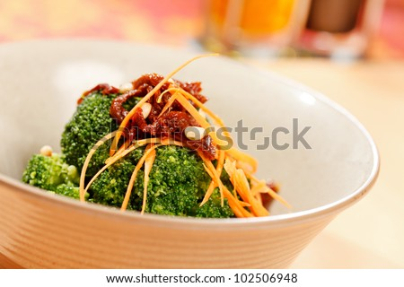broccoli with carrot and dried tomato