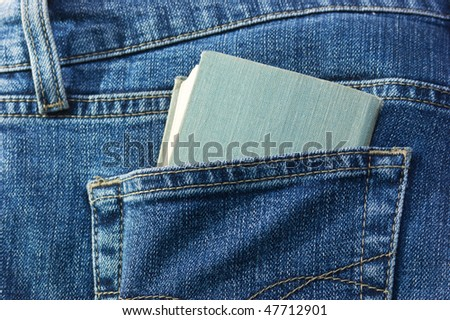 brochure in the back pocket of jeans