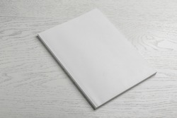 Brochure with blank cover on wooden background. Mock up for design
