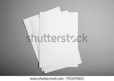 Brochures of A5 format on a gray background, a place for design. #792293821