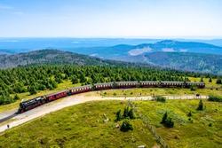 Brocken Germany: Steam train climbing the tracks towards the top of Brocken Mountain