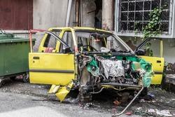 Broken accident car in a housing development in Kuala Lumpur, Malaysia.