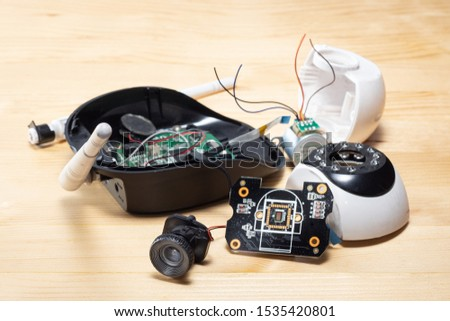 broken and damage the IP camera on pine wood table stock photo