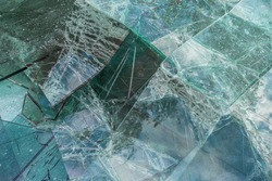 Broken and damaged glass panes in the recyclables container