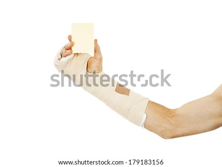 Broken arm bone in cast holding a blank card. Isolated on white background
