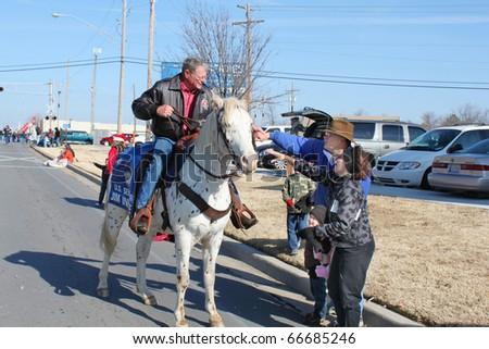 BROKEN ARROW, OK-DECEMBER 4: Oklahoma Senator Jim Inhofe (R) rides in Christmas Parade in Broken Arrow, Tulsa's suburb, on December 4, 2010. Inhofe will not ride in Tulsa's Holiday Parade of Lights - stock photo