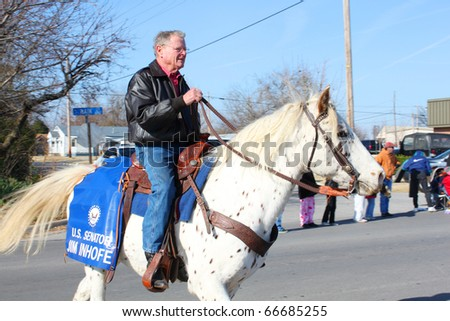 BROKEN ARROW, OK-DECEMBER 4: Oklahoma Senator Jim Inhofe (R) rides in Christmas Parade in Broken Arrow, Tulsa's suburb, on December 4, 2010. Inhofe will not ride in Tulsa's Holiday Parade of Lights