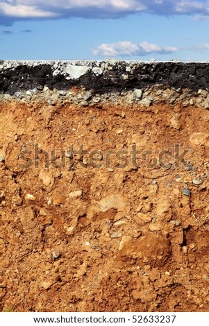 broken asphalt road excavation earthquake cross section blue sky [Photo Illustration] - stock photo