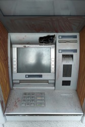 broken ATM. Bank robbery and broken ATM concept. broken ATM. Bank robbery and broken ATM concept. the robbery is carried out through a hole by short-circuiting the wires