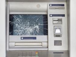 Broken ATM with broken glass. Act of vandalism and hooliganism.